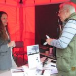 Laura Saunsbury giving legal advice on SAGBNI stand Bisley