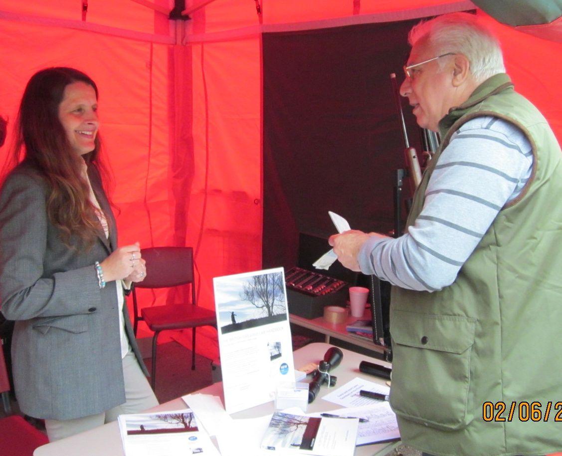 Laura Saunsbury giving legal advice on SAGBNI stand Bisley